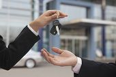 Salesman handing over car keys