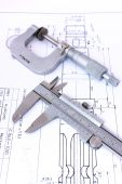 Micrometer And Caliper On Blueprint Vertical