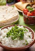 traditional mexican food: cilantro and lime rice, chicken fajitas, fajita peppers, burritos, tortill