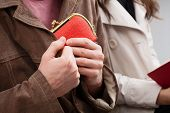 picture of sneaky  - A man hiding an elegant wallet into is jacket - JPG