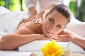 Young beautiful woman relaxed in spa environment