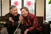 Chinese Mature Couple Talking On The Phone