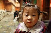 Asian Girl 4 Years Old, Close-up Portrait On Rural Street.