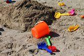 Children's Toys On The Beach Sand