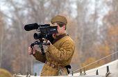 KIEV, UKRAINE -NOV 3 Estonian TV cameraman wears historical Soviet uniform working during historical reenactment of WWII, Battle for Kiev 1943 on November 3, 2013 in Kiev, Ukraine