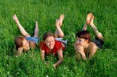 Girls Lay In A Green Summer Grass