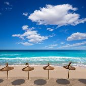 stock photo of tomas  - Menorca sunroof row tropical beach at Balearic islands of Spain - JPG