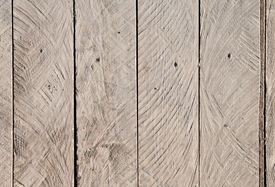 picture of uncolored  - Close up texture of rough uncolored wooden lining boards - JPG