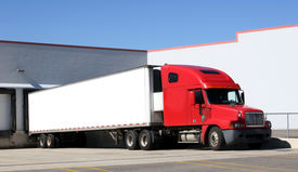 picture of tractor-trailer  - tractor trailer sitting at a loading dock - JPG