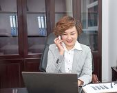 Oriental Business People Make A Phone Call