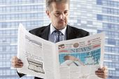 Business man reading a newspaper, City backgrounds