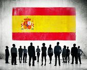Spanish flag and a group of business people.