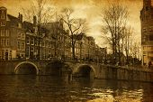 Canal in Amsterdam, The Netherlands.  Added paper texture.