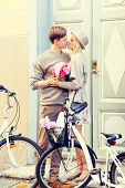 summer holidays, vacation, bikes, love and relationship concept - couple with bicycles in the city