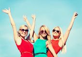 holidays and tourism, friends, hen party, blonde girls concept - three beautiful women waving hands
