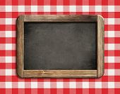 stock photo of chalkboard  - chalkboard or blackboard on picnic tablecloth - JPG