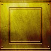 Golden metal plate. Industrial background