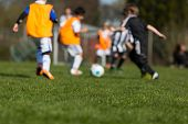foto of football pitch  - Two teams of children playing a match of soccer during summer time.