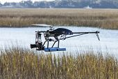 drone helicopter with camera flying over water