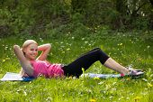 Woman Doing Crunches In Park