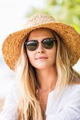 Fashion lifestyle, Attractive woman in sun hat and sunglasses at the beach