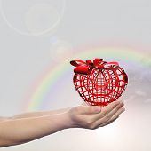 Concept or conceptual 3D red heart sign or symbol with ribbon held in hands by a man, woman or child