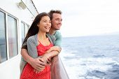 stock photo of passenger ship  - Cruise ship couple romantic enjoying travel on boat embracing looking at view - JPG