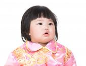 Baby wearing cheongsam suit for Chinese New Year