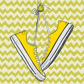 stock photo of chevron  - Pair of yellow sneakers on chevron background drawn in a sketch style - JPG
