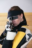 Young Woman Shooting Target