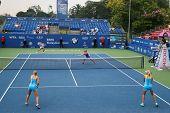 KUALA LUMPUR - APRIL 19, 2014: Chan Yung-Jan and Zheng Saisai take on Olga Savchuk and Lyudmyla Kichenok in the women's semifinals of the BMW Malaysian Open tennis is Kuala Lumpur, Malaysia.