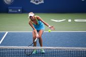 KUALA LUMPUR - APRIL 19, 2014: Lyudmyla Kichenok returns in the semifinals of the BMW Malaysian Open