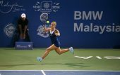 KUALA LUMPUR - APRIL 20, 2014: Dominika Cibulkova of Slovakia hits a return in the Singles final of