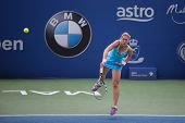 KUALA LUMPUR - APRIL 19, 2014:  Olga Savchuk smashes in the semifinals of the BMW Malaysian Open in