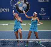 KUALA LUMPUR - APRIL 19, 2014: Olga Savchuk and Lyudmyla Kichenok (white cap) come in together for a