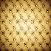 Abstract background texture of an old natural luxury, modern style leather with rhombs. Classic gold