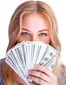 Closeup portrait of young lady covers her face with a wad of american dollars, isolated on white bac