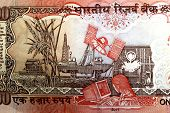 Indian 1000 Rupee Backside Representing Satellite Communication, Oil Exploration, Research In Crops