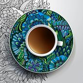 Cup of coffee and hand drawn floral ornament