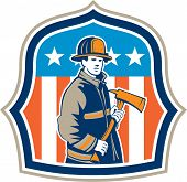 stock photo of firemen  - Illustration of an american fireman fire fighter emergency worker holding a fire axe viewed from front set inside shield crest with american stars and stripes flag in the background done in retro style - JPG