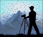 Silhouette Of The Photographer On A Background Of Mountains
