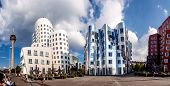Panoramic view of three futuristic building Neue Zollhof located in Media Harbor