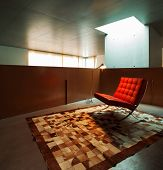 house interior, waiting room with red armchair