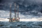 stock photo of  rig  - Oil Rig at sea during a storm.