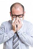 Businessman sneeze