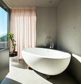 Modern house, detail bathroom, ceramic bathtub
