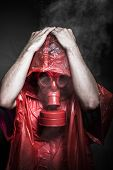 Gas, nuclear disaster, man with red mask and plastic suit