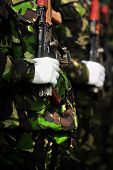 stock photo of kalashnikov  - Detail with a soldier