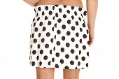 image of short skirt  - A woman in her short black and white polka dot skirt - JPG