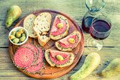 Sandwiches With Italian Salami And Pears On The Wooden Board